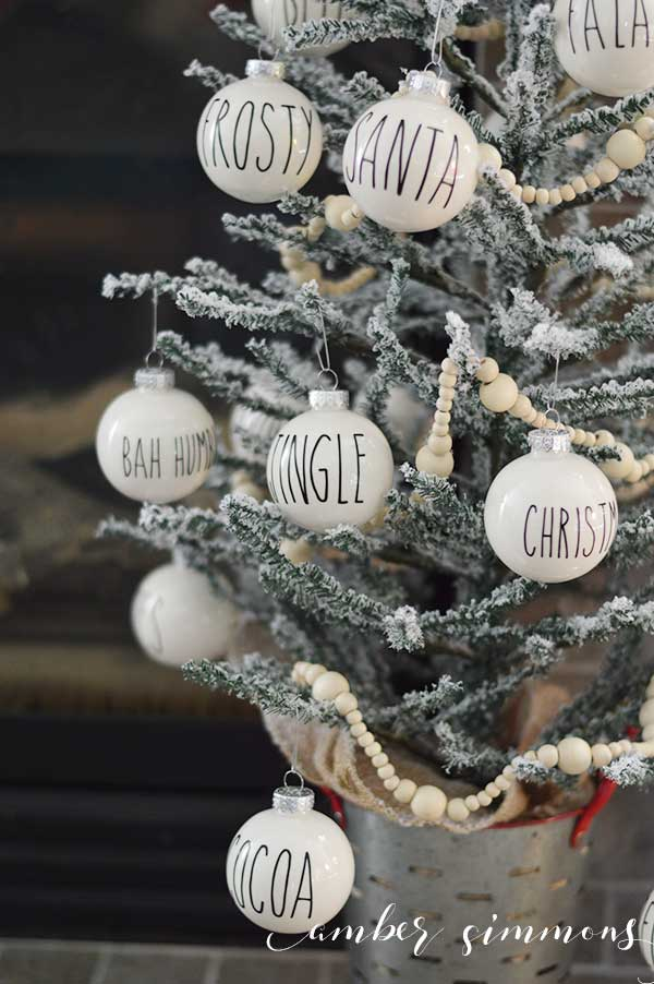 This Rae Dunn Inspired Christmas Ornament DIY will give your tree the perfect amount of simplicity while still being fun. And they will go with any <a href=