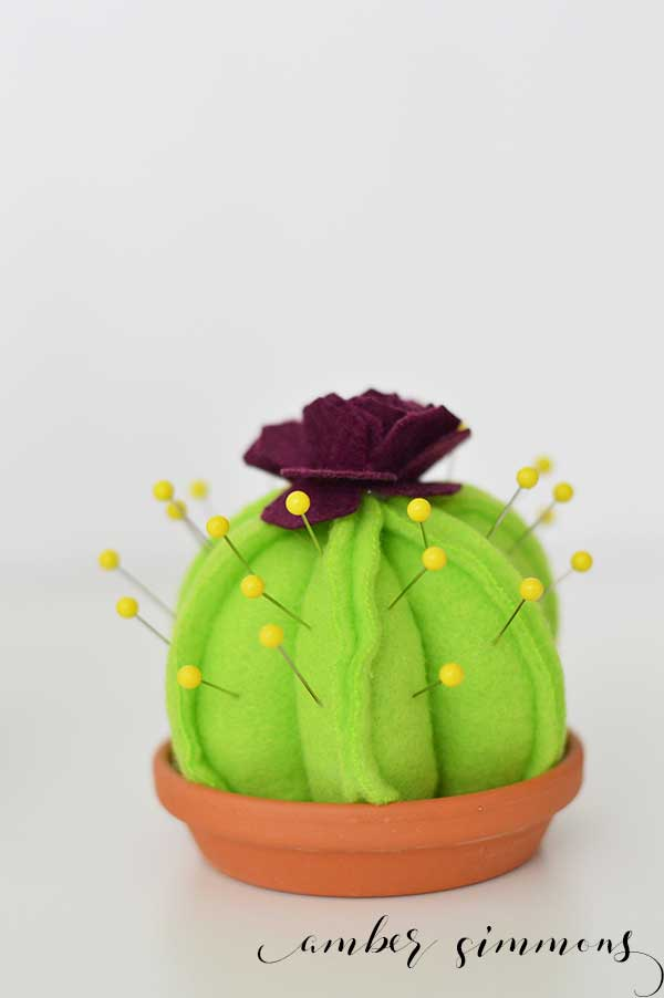 This super cute DIY Cactus Pin Cushion is so simple to make even a beginning sewer can make one. And with the Cricut Maker pattern, cutting them out is a breeze. | ambersimmons.com | #girlsnight #sewing #cacti #succulents