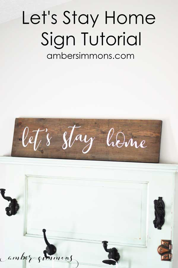Tutorial on how to use Cricut Iron-on on wood to make a cute farmhouse style Let's Stay Home Sign that looks hand painted without all the mess of painting. #cricut #ironon