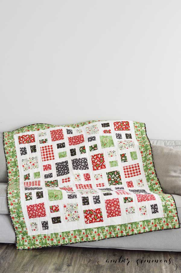 How to Finish Your Quilt with Riley Blake Quilt Kit and the Cricut Maker by piecing the blocks, quilting, and binding. #ad #CricutMade #MyCricutQuilt #RileyBlakeDesigns