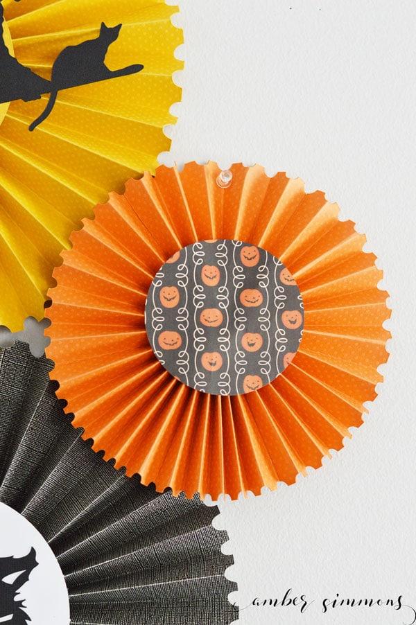 A simple tutorial for DIY Halloween rosettes with the Cricut Scoring Wheel. #CricutMade #Cricut #ad