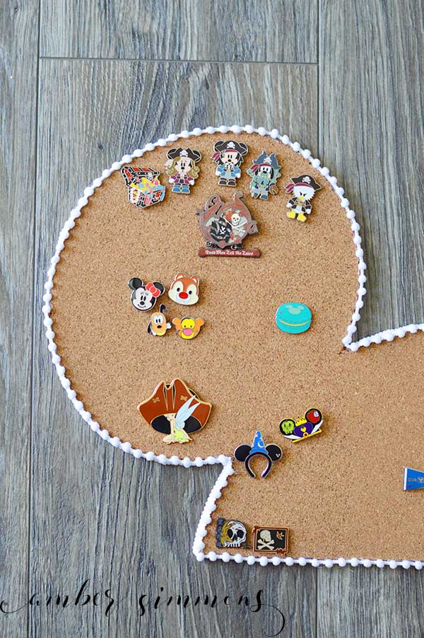 A DIY tutorial for a Disney Trading Pin cork board to keep all your Disney pins together in one magical place.