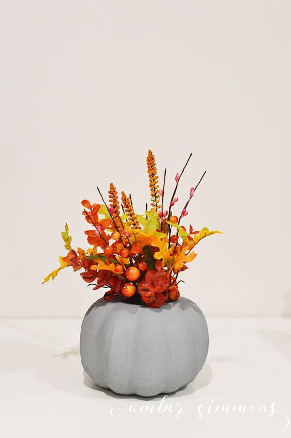 This easy beautiful modern faux cement pumpkin planter will raise your autumn decor game with its industrial vibe.