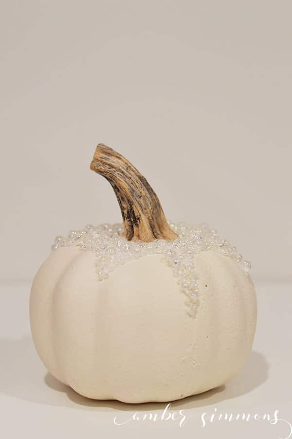This simple DIY for how to create a stunning pumpkin dripping in pearls will class up your fall display in no time without a major dent to your wallet.
