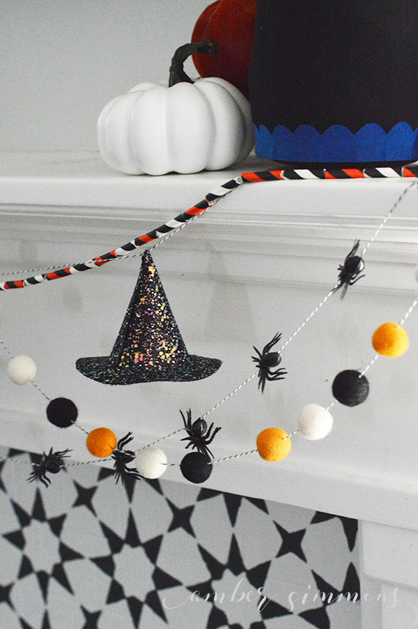 This tutorial for how to make a glittered mini witch hat garland will a little spooky glam to any Halloween decor.